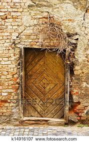 wall with very old wooden door