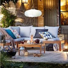sofa style garden seating with cushions and throws