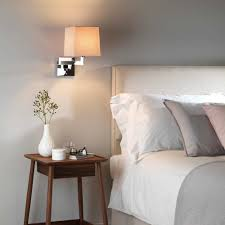 bedroom sconce lighting. Bedroom With Swing Arm Wall Sconces Features Orange Shades And Modern Furniture Sconce Lighting