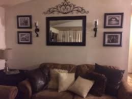 Small Picture behind couch wall in living room mirror frame sconces and metal