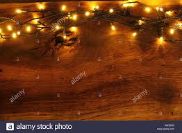 Wood With Lights Wooden Board With Fairy Lights As A Background Stock Photo