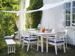 patio patio chair patio furniture a white fabric cover a dining room with