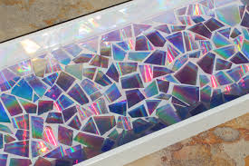 this mosaic tray has about a 1 4 thick glossy resin coating all the tile pieces nothing but a smooth wonderful texture and so shiny
