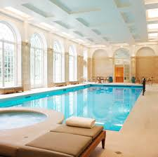 amazing indoor swimming pool design ideas huz name designs luxury with padded sunbathing chair and large amazing indoor pool house