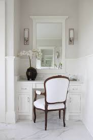 built in marble top vanity and white framed mirror flanked by restoration hardware keller sconces paired with bergere chair bathbar lighting guru blog