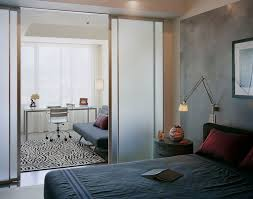 home office and bedroom modern bedroom idea in boston with gray walls bedroom converted home