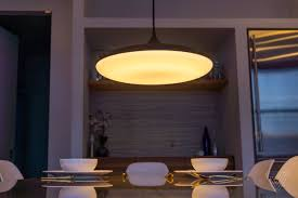 dinner table lighting. Philips Is Introducing One Of Its Biggest Hue Lights Yet: A Full-on Fixture Meant To Hang From Your Ceiling And Illuminate Dinner Table With Big, Lighting