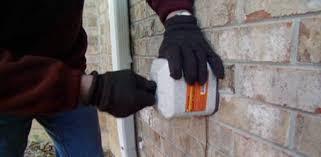 installing an insulated foam hose bibb cover on an outdoor spigot