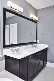 dark light bathroom light fixtures modern. Bathroom Charming Lighting Fixtures Over Mirror: Elagant Grey Wall And Dark Wood Cabinet With Light Big Mirror White Modern T