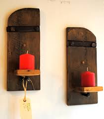 rustic pair of wooden candle holder wall sconce design with small wood platform with red