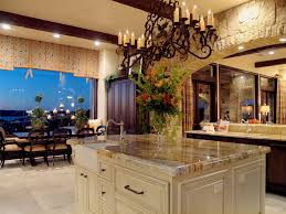rustic iron chandelier over marble countertop kitchen island
