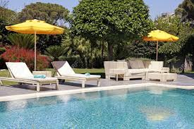 white patio furniture. Stock Photo - White Outdoor Furniture In The Garden Near Swimming Pool For Relax On Beautiful Summer Resort Patio