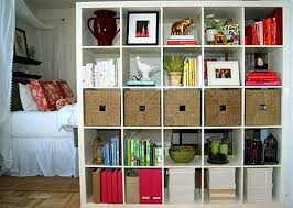 Photo Of A Storage Unit Being Utilized As A Room Divider