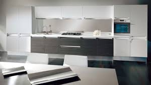 white kitchen cabinets with wood trim