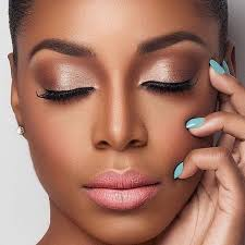 i love this eye shadow the lipstick the blue nail polish everything just seems to match perfectly with her dark skin