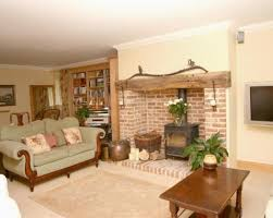 photo of beige white lounge with brick fireplace wood burner