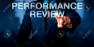 Words For Employee Evaluation Male Manager Is Touching The Words Performance Review Onscreen