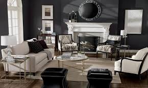 stunning black wall color with electric fireplace and pair of ethan allen chairs near brown area