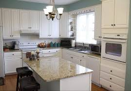 narrow kitchen design with white appliances and antique pendant lights above small island also using faucet beside windows