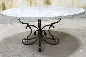 round zinc table with cast iron base