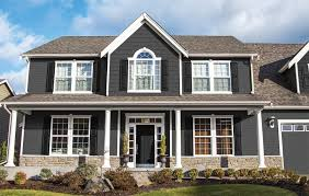 Choosing a gorgeous gray paint color like Flagstone is an easy way to make  your home feel instantly modern.Pairing it with dark trim helps it look  mature ...