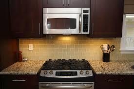 kitchen brown glass backsplash. Delighful Brown Brown Cabinets With White Subway Tile Backsplash Travertine  Glass Kitchen  To Kitchen Brown Glass Backsplash C