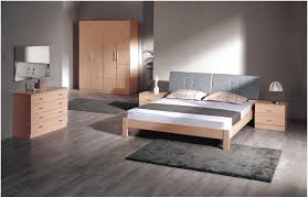 fancy bedroom decorating ideas with full brown wooden frame wooden furniture and wooden floor