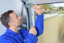 garage door repairmanHow to Tell if Your Garage Door Repairman is Qualified  A Garage