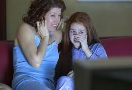 kids watching tv at night. mother and daughter watching late night tv kids at i