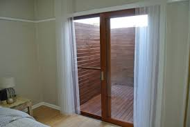 solid cedar timber sliding doors with fly screen 2100wx2100h brisbane city brisbane north west 1 of 5