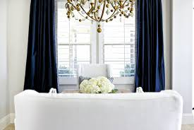view full size white and navy dining room features gold chandelier oly studio alice