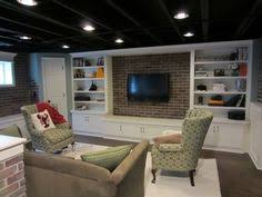 unfinished basement lighting ideas. Unfinished Basement With Beam Ceiling, Carpeting And Built-in  Flat-screen TV Unfinished Lighting Ideas N