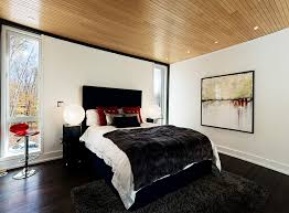 view in gallery wooden ceiling gives the bedroom in black and red a warm inviting appeal bedroombreathtaking stunning red black white