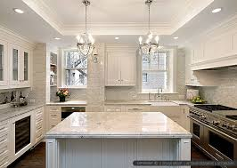 white kitchen with calacatta gold backsplash tile