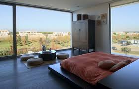 feel the tranquility of japanese bedroom interior designs ideas with low bed and round floor cushion plus coffee table also beautiful view look from glass bedroom japanese style