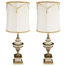 a hollywood regency style pair of brass cream colored stiffel table lamps