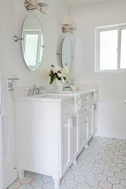 love it or list it amazing master bath features a white footed bathroom vanity divided into his and her sections topped with white quartz framing his