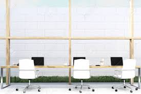 long office desks. Front View Of Long Office Table Standing Near A White Brick Wall On Grass. There Desks E