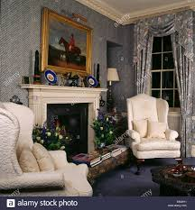 Wing Chairs For Living Room Cream Wing Chairs On Either Side Of Fireplace In Traditional Stock