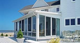 white aluminum frame three season room with single slope roof