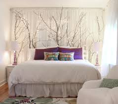 Ideas for using branches as indoor decor- here, placed behind a headboard -  hawk