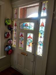 antique victorian front door matching side panels with beautiful stained glass
