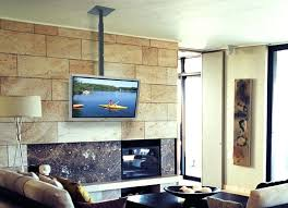 hang tv over fireplace hanging from ceiling mount wall stone hang tv over fireplace