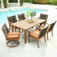7 piece wicker outdoor dining set with reddish brown cushion teak table large round n