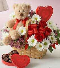 gift package with flowers teddy bear and chocolates