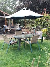 outdoor glass table 4 chairs umbrella for in garden exploded