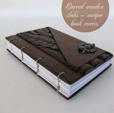of a book cover i use the beautiful and rich wood for my carving or i plete it with authentic accents each cover is unique and one of a kind