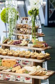 Rustic buffet table of bread bowls and dips. Food Display With Local Fresh Cheeses Pastries Crackers And Fresh Flower Displays Eventdesign Catering Foodbuffet Buffet Food Food Displays Catering Food