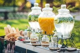 glass jars of lemonade and decor on wedding candy bar stock photo
