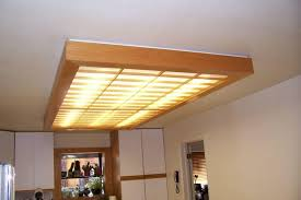 kitchen fluorescent lighting. Exellent Kitchen Narrow Fluorescent Lighting With Wooden Patterns In The Kitchen Ceiling   Cost Saving Using For